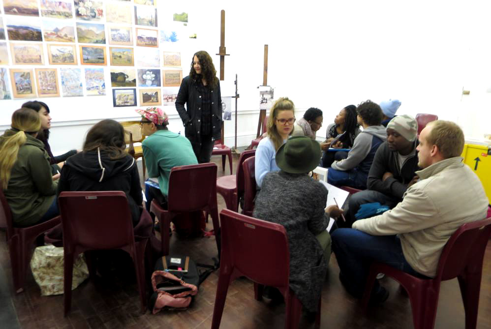 Click the image for a view of: Andrew Lewis, Curator of the Tladi with the UCT CCA students