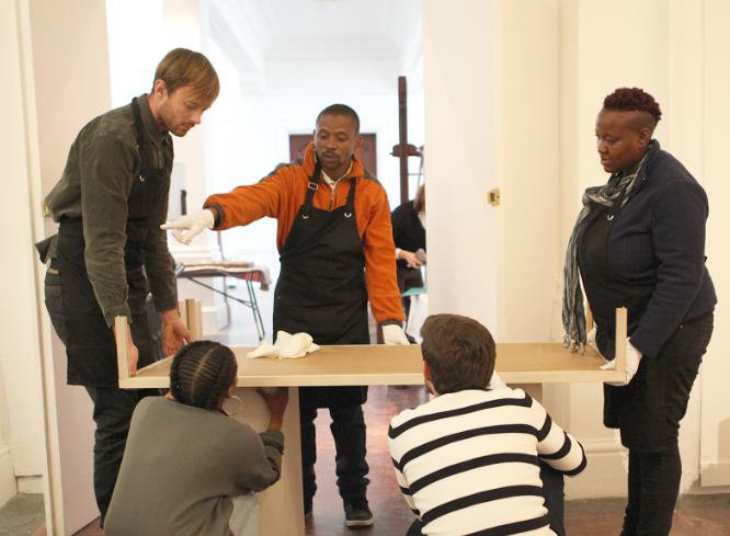 Click the image for a view of: The exhibition in progress with the students working